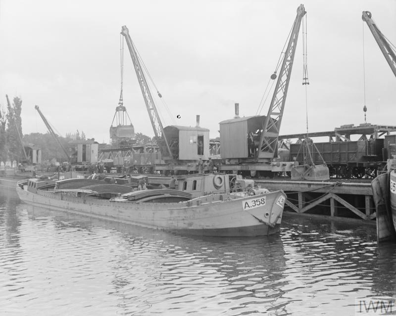 A barge unloading at a quay on the canal at Bergues, France, 23<sup>rd</sup> August 1917